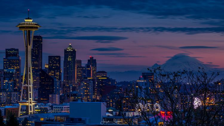 Sunset over the Seattle skyline with the Space Needle in the foreground and Mt Rainier in the background
