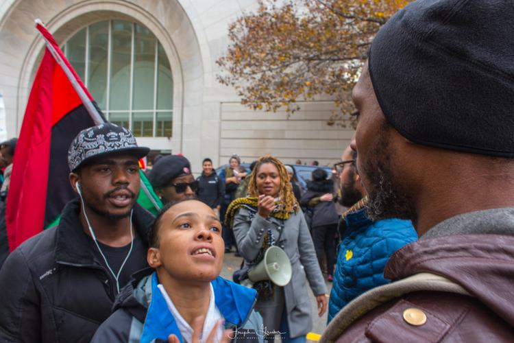 Approximately 50 protesters gather outside of the Pentagon City Mall in Arlington, Virginia on Saturday, November 29th, 2014 to show solidarity with Ferguson, Missouri protests. A small group of protesters showed frustration in which the manner the protests were being handled.