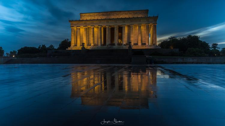 The Lincoln Memorial reflects in the wet granite after thunderstorms passed through the DC area