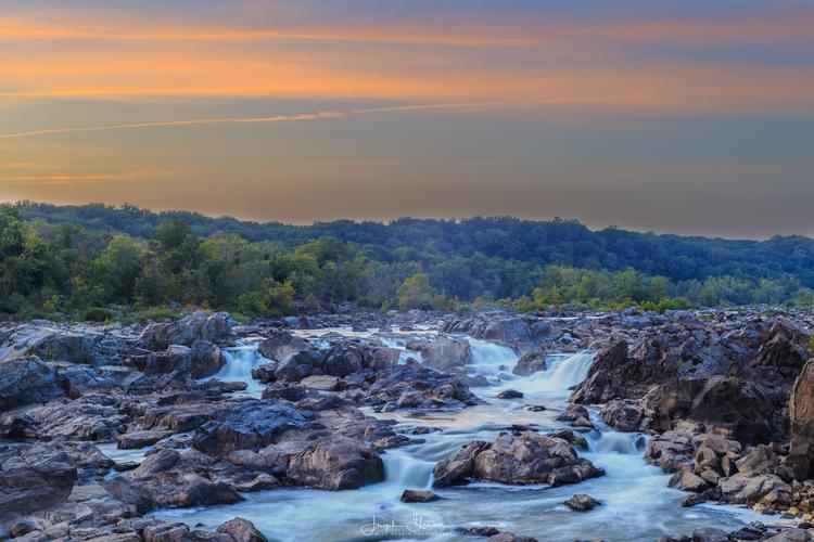 The orange glow of sunset over the Potomac River 'Great Falls' on Labor Day weekend