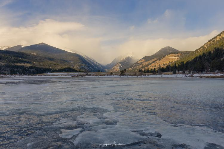 Three of the mountains in Rocky Mountain National Park can be seen in the distance from a frozen Sheep Lakes