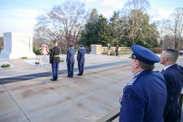 Officers from the United States Air Force Auxilary, Civil Air Patrol, salute the Tomb of the Unknown Soldier during a wreath laying at Arlington National Cemetery