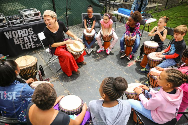 The Drum Lady performing at the Harrison Rec Family Funk Pavilion hosted by The DC Public Library and World Beats & Life for Funk Parade, a festival celebrating music and arts in Washington, DC's U Street Neighborhood. Saturday, May 7, 2016.