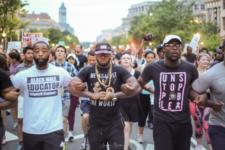 Protestors march down Pennsylvania Avenue from the White House to the United States Capitol Building after recent police involved shootings of Alton Sterling and Philando Castile