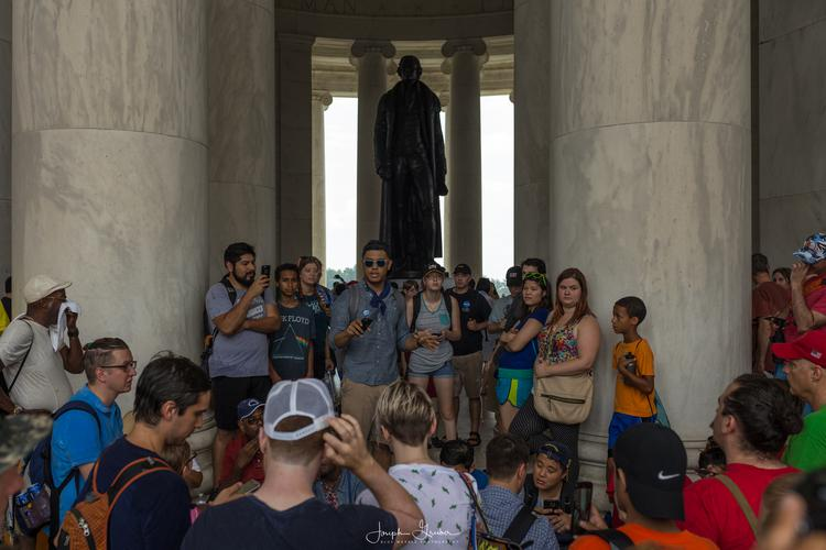 A statue of Thomas Jefferson at the Jefferson Memorial overlooks those gathered for the DCPokewalk