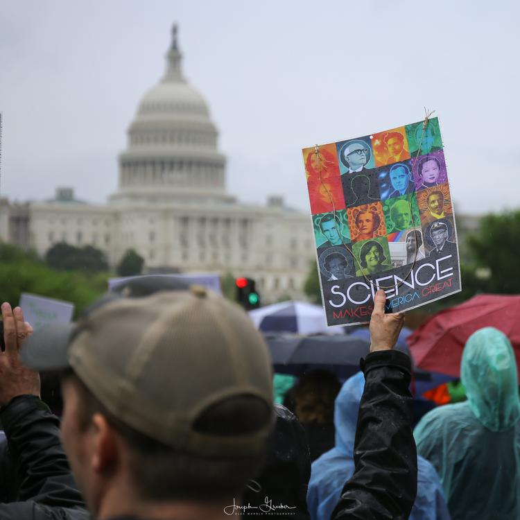 Activists and protesters march to the United States Capitol as part of the March for Science rally on Earth Day