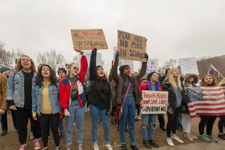High school students from across the D.C. area protest gun control laws and gun reform in front of the White House
