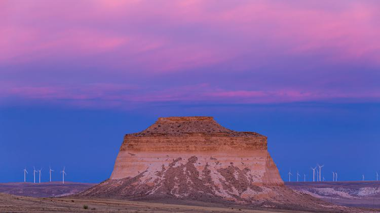 Shades of pinks and purples highlight the skies above the Pawnee Buttes on the plains of eastern Colorado in Pawnee National Grassland