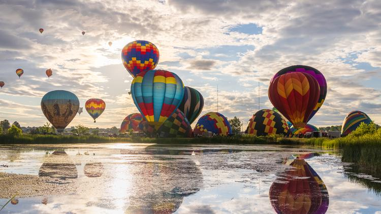 Hot air ballons prepare for an early morning mass ascension in northern Colorado