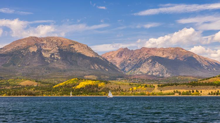 Sailboat's enjoy the first signs of fall in Colorad's Summit County on Dillon Reservoir